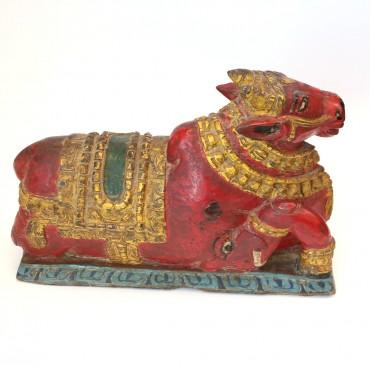 Statuetta di mucca in legno